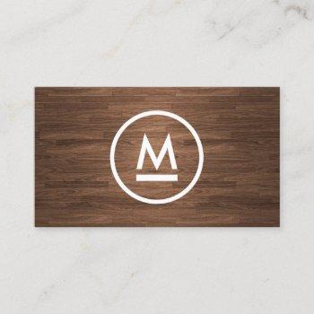big initial modern monogram on brown wood business card