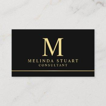 black and gold elegant monogram business card