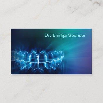 dentist shimmering blue teeth smile business card