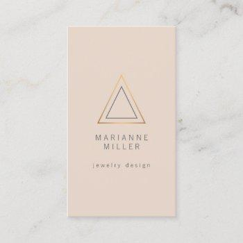 edgy rose gold triangle logo on peach business card