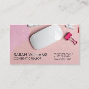 electronic desktop workspace pink background business card