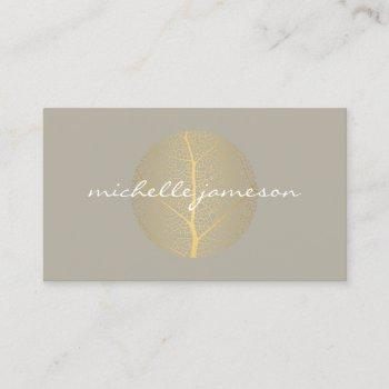 elegant gold leaf logo on tan business card