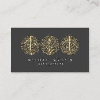 elegant gold leaf trio logo on dark gray business card