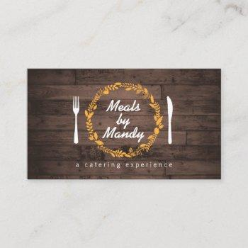 fork and knife wreath on woodgrain catering, chef business card