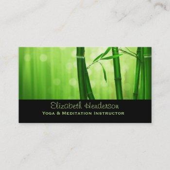 green bamboo with pale bokeh lights in the back business card