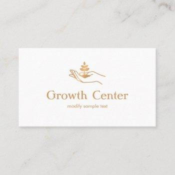 hand holding leaf plant  life coach and therapist business card