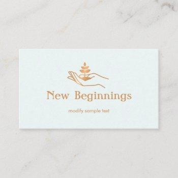hand holding leaf plant  wellness  counselor business card