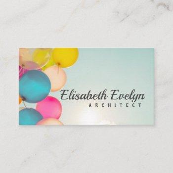 hand holding multi colored balloons business card