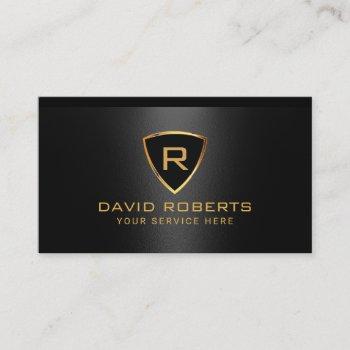 modern gold shield monogram logo black metallic business card