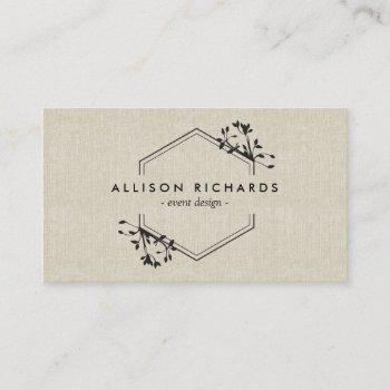 ornate vine and leaf emblem on linen business card