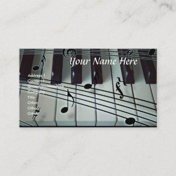 piano keyboard and music notes business card
