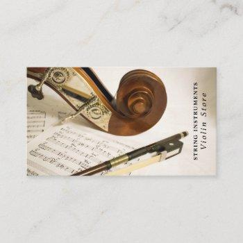 violin note sheet, musical instrument store business card