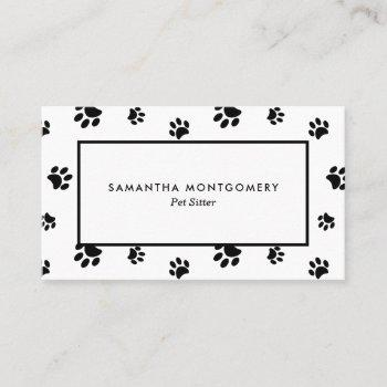 white and black paw prints professional pet sitter business card